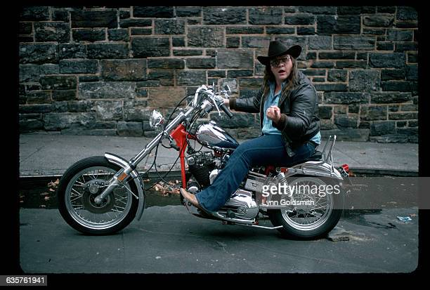 Portrait of Meatloaf seated on his motorcycle Photograph 1978