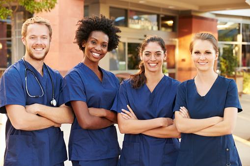 Portrait Of Medical Team Standing Outside Hospital 504820370
