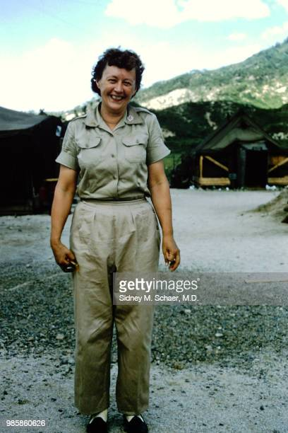 Portrait of medical worker Merl Kathlow of the 8063rd MASH as she poses in a clearing surrounded by US Army tents South Korea January 1952