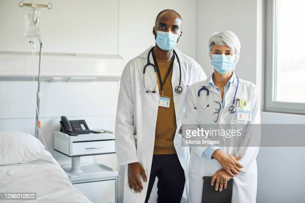 portrait of medical workers in hospital - coronavirus doctor stock pictures, royalty-free photos & images