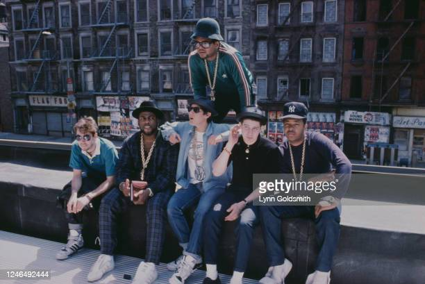 Portrait of members of American Rap groups Beastie Boys and Run-DMC as they pose on a rooftop, New York, New York, 1987. Pictured are, MCA , Mike D ,...