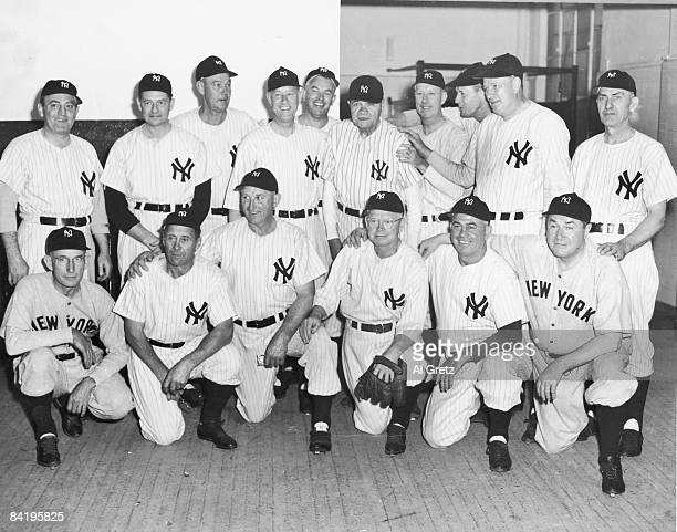 Portrait of members of the 1923 World Series-winning New York Yankees as they pose together at a reunion of Yankee All-Stars, New York, New York,...