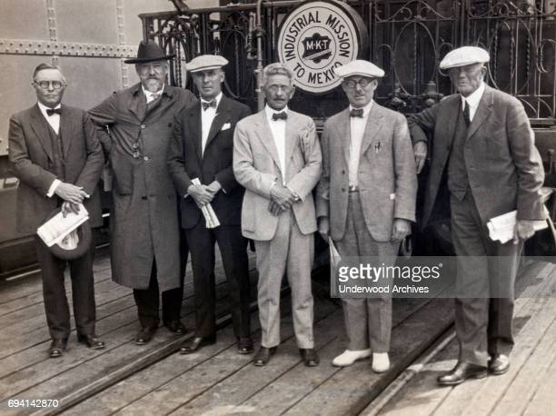 Portrait of members of the American Industrial Mission during a tour as they pose beside their special train Mexico September 28 1924 Pictured are...