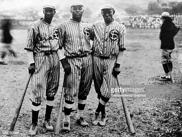 Portrait of members of the Santa Clara baseball teams outfield as they pose in Almendares Park, Havana, Cuba, 1924. Pictured are, from left, Campeon...