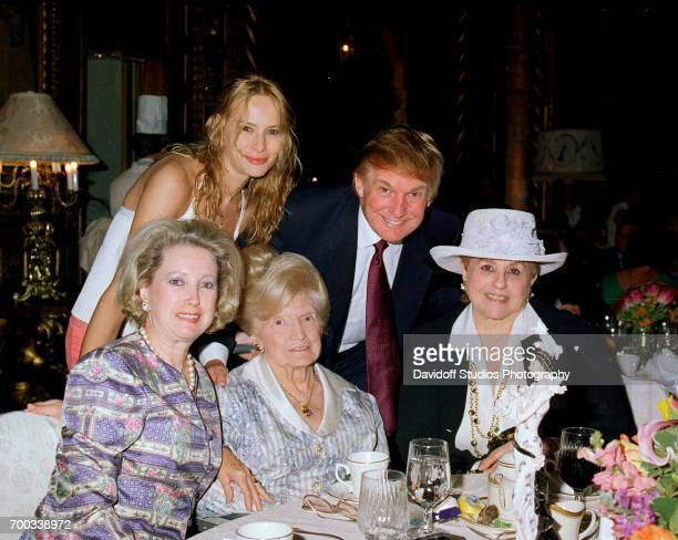 Portrait of members the Trump family as pose together at the MaraLago club Palm Beach Florida circa 2000 Picture are standing former model Melania...
