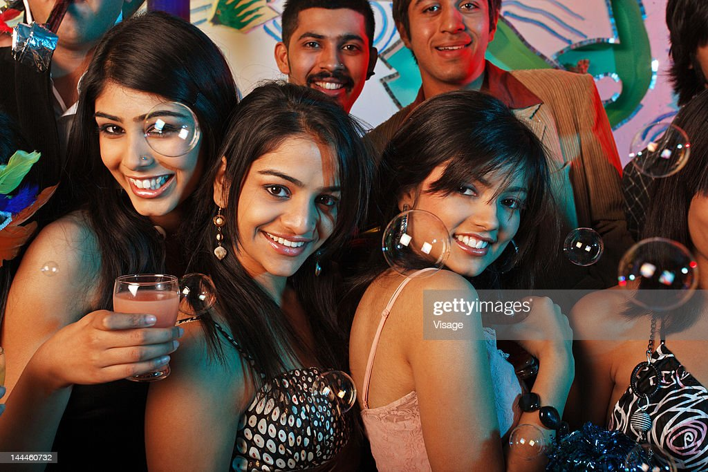Portrait of men and women at a party : Stock Photo