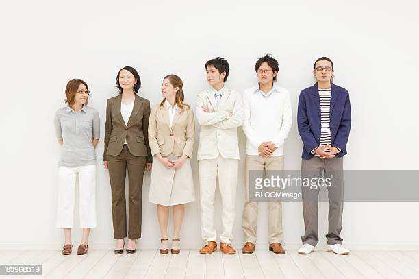 Portrait of men and women standing in a row