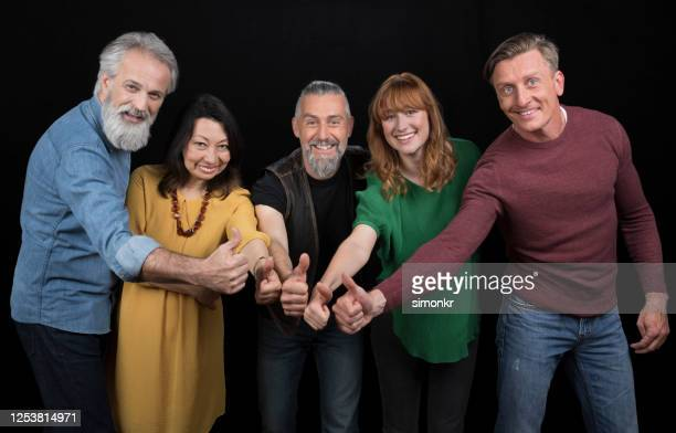 portrait of men and women standing together - five people stock pictures, royalty-free photos & images