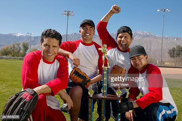 Portrait of Men in a Winning Baseball Team with a Trophy
