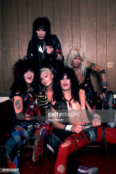 Portrait of metal band Motley Crue clockwise from lower left Nikki Sixx Mikc Mars Vince Neil and Tommy Lee with the adult film star Seka at the...