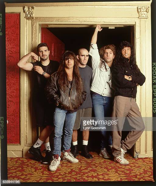 Portrait of metal rock band Anthrax posing in a doorway Photograph 1991