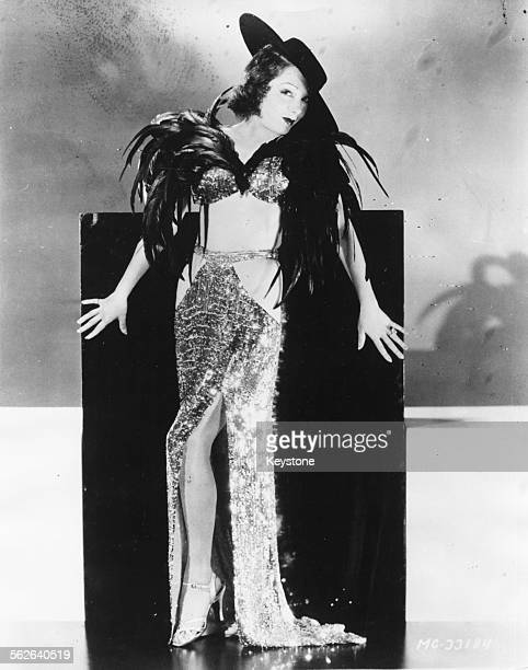 Portrait of Mexican actress Lupe Velez wearing a revealing feather outfit circa 1931