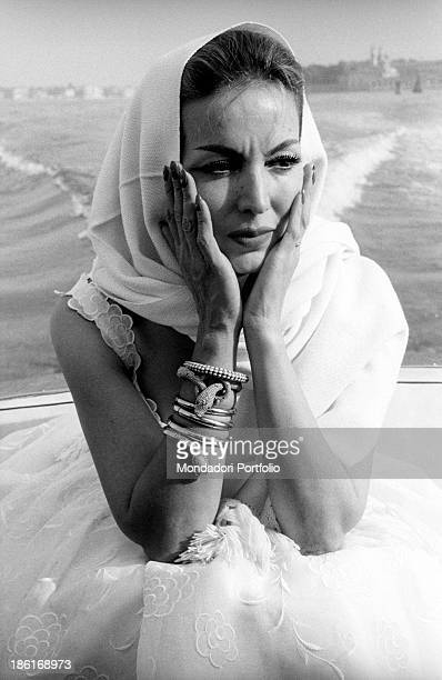 Portrait of Mexican actress Maria Félix wearing a scarf around her head on a boat She's taking part in the Venice Film Festival Venice August 1959
