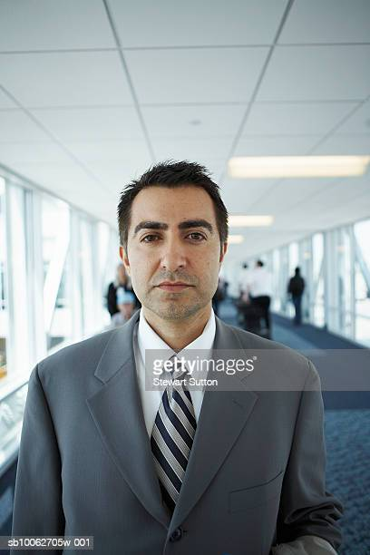 Portrait of mid adult business man in airport