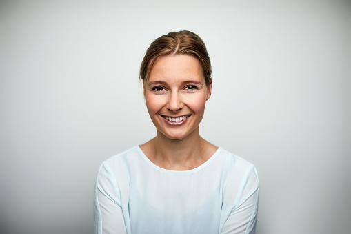 Portrait of mid adult businesswoman smiling - gettyimageskorea