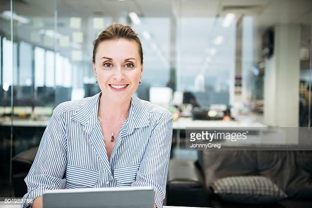 Portrait of mid adult Caucasian businesswoman smiling towards camera