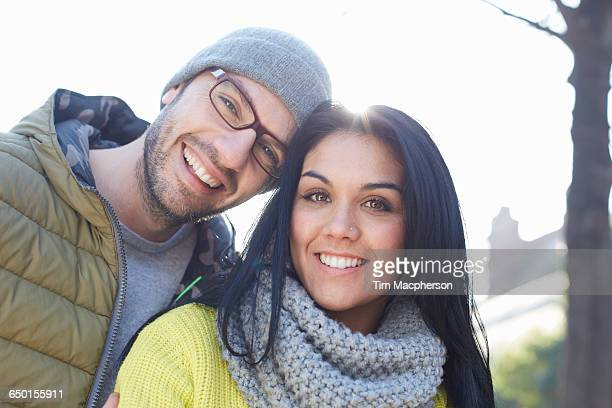 Portrait of mid adult couple looking at camera smiling