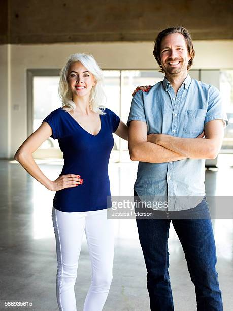 portrait of mid adult couple - short sleeved stock pictures, royalty-free photos & images