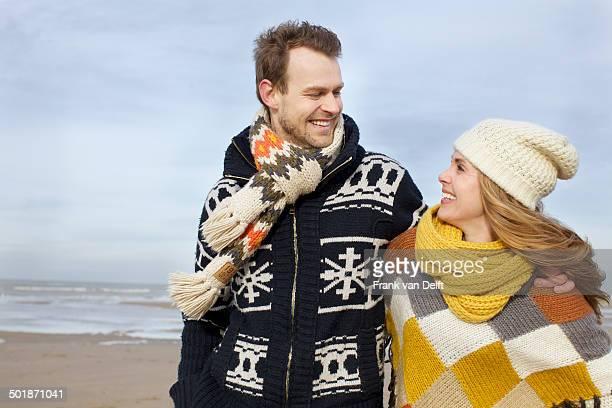 Portrait of mid adult couple strolling on beach, Bloemendaal aan Zee, Netherlands