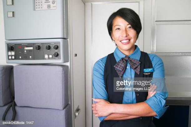 Portrait of mid adult female air hostess