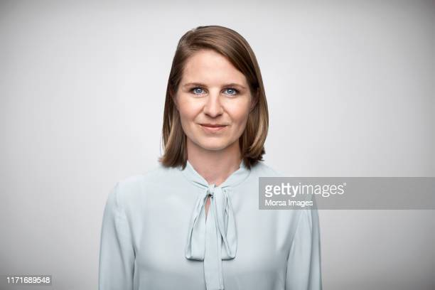 portrait of mid adult female owner wearing top - gray eyes stock pictures, royalty-free photos & images