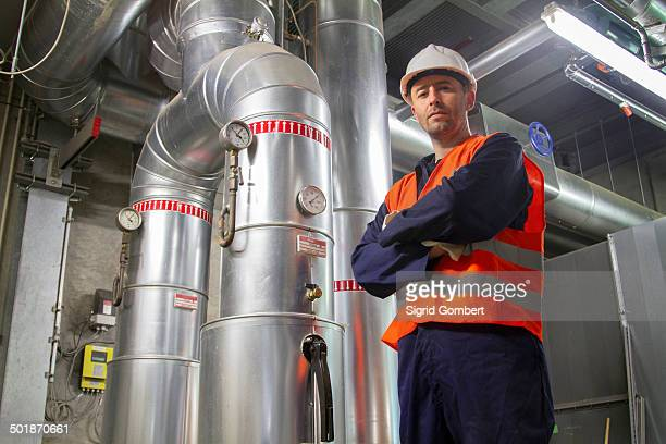 Portrait of mid adult male technician in power station