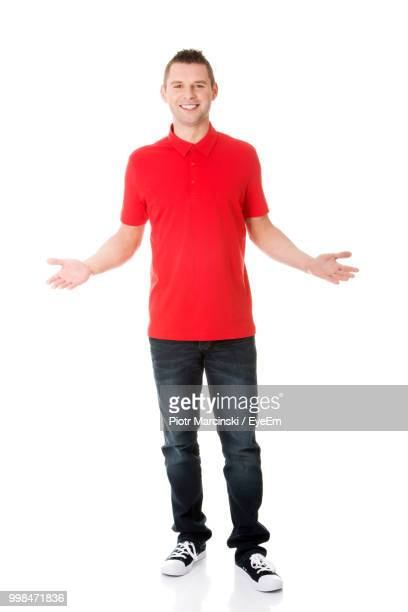 portrait of mid adult man gesturing against white background - red pants stock pictures, royalty-free photos & images