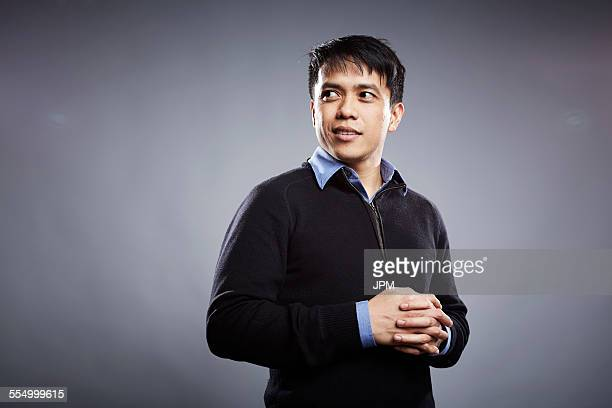 Portrait of mid adult man, hands clasped