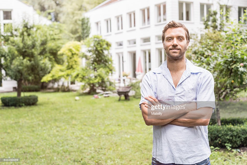 Portrait of mid adult man in front of house : Stock Photo