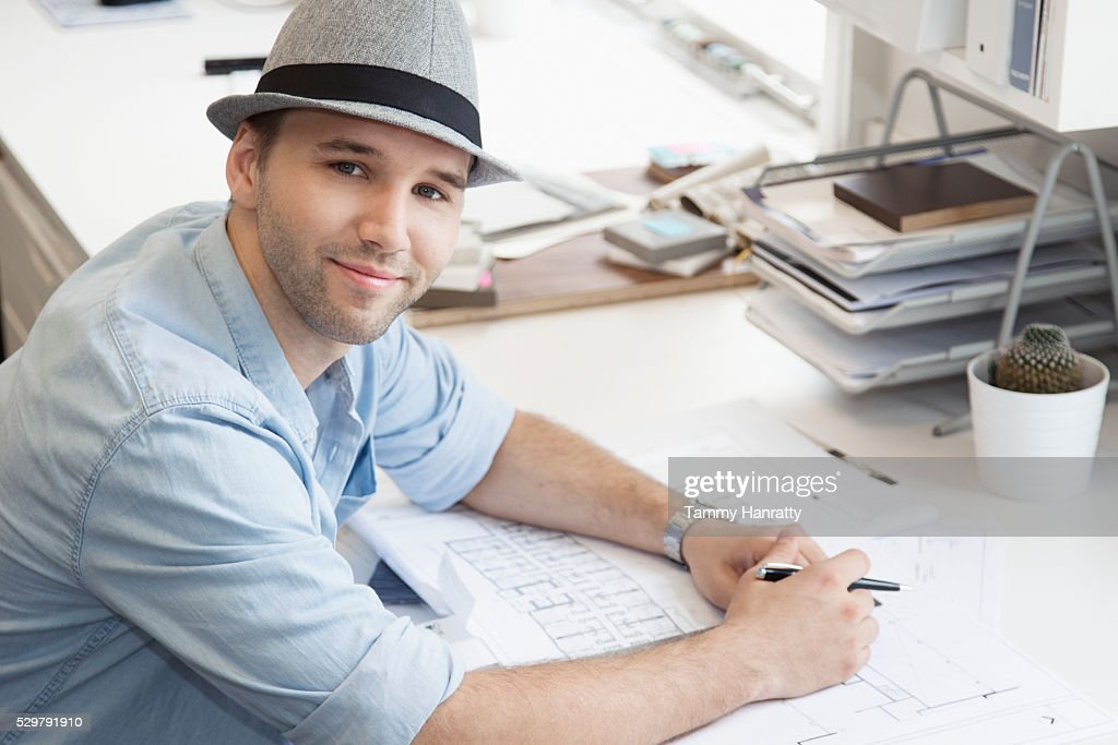 Portrait of mid adult man in office : Stock Photo