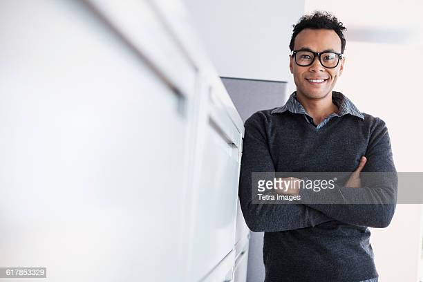 Portrait of mid adult man in office
