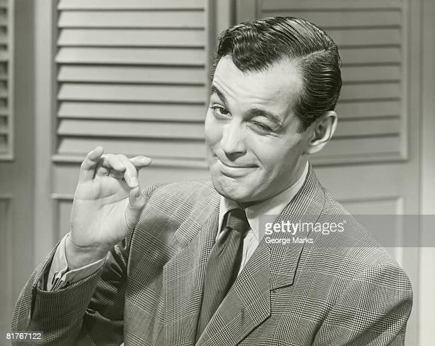 Portrait of mid adult man making OK gesture