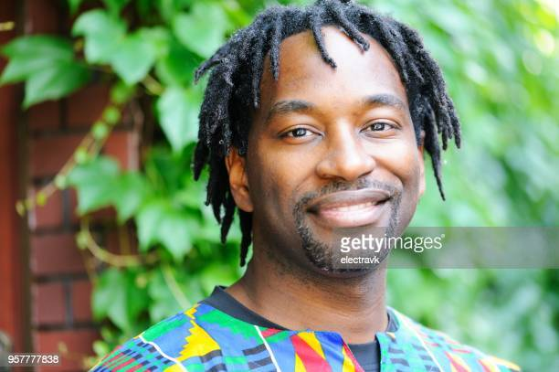 portrait of mid adult man - dashiki stock photos and pictures