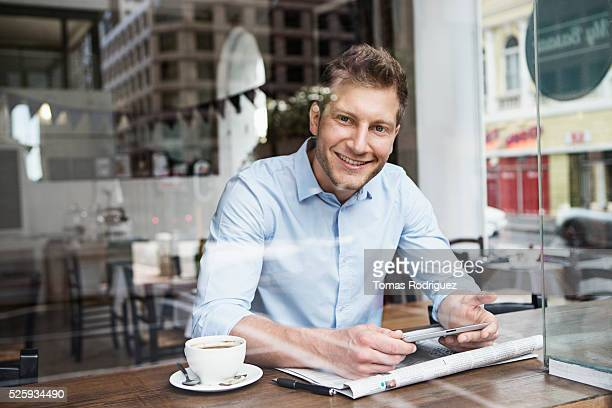 Portrait of mid adult man relaxing in cafe