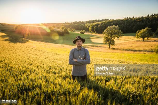 Portrait of mid adult man, standing in field, Neulingen, Baden-Wrttemberg, Germany