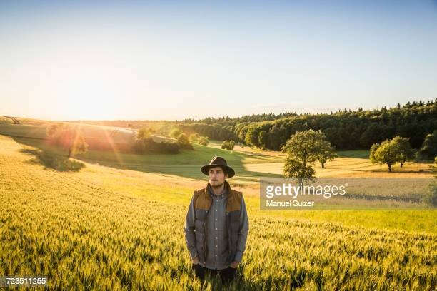portrait of mid adult man, standing in field, neulingen, baden-wrttemberg, germany - baden württemberg stock photos and pictures