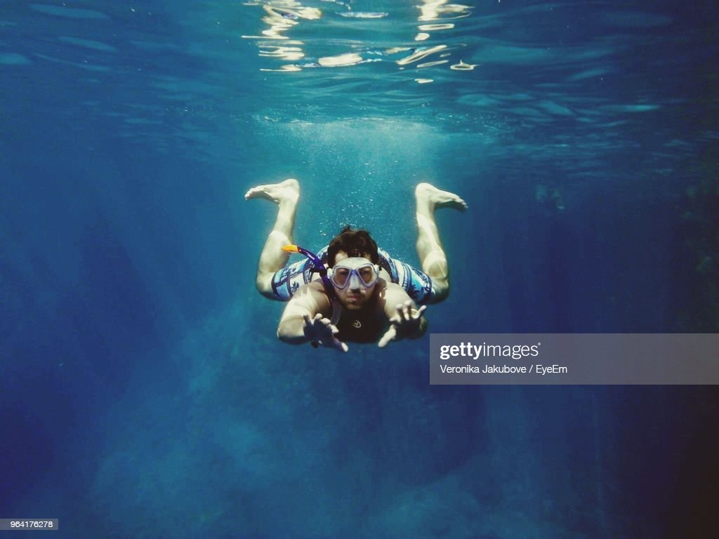 Portrait Of Mid Adult Man Swimming In Sea