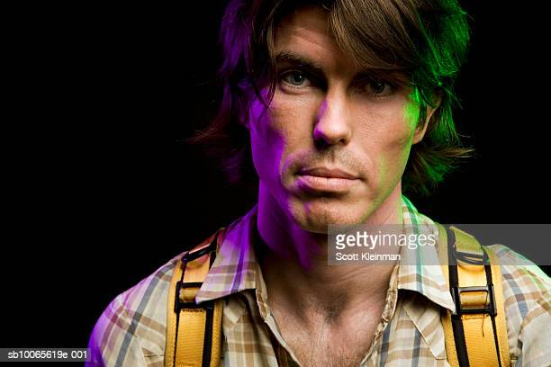 Portrait of mid adult man with backpack, studio shot
