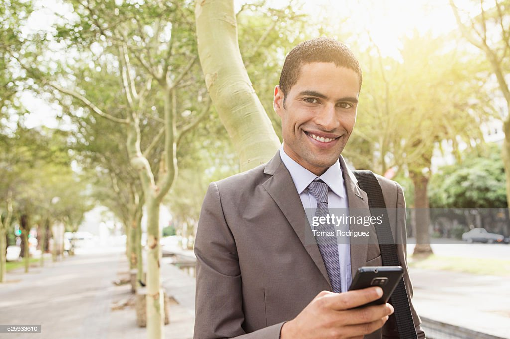Portrait of mid adult man with cell phone : Foto de stock