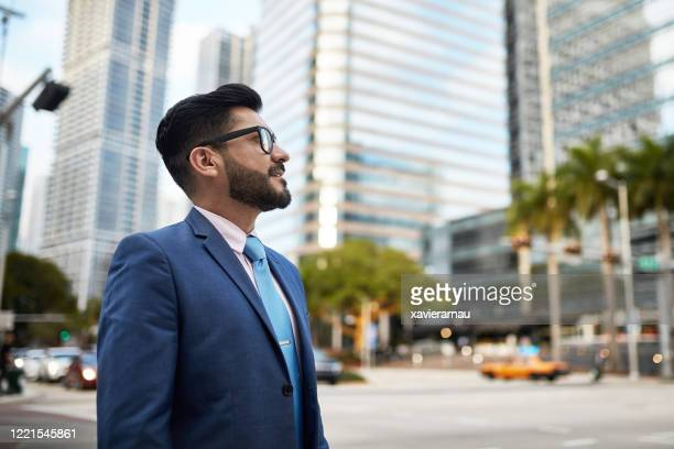 portrait of mid adult miami businessman in downtown district - mid adult stock pictures, royalty-free photos & images