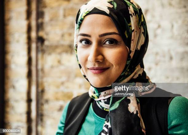 Portrait of mid adult woman in hijab smiling towards camera