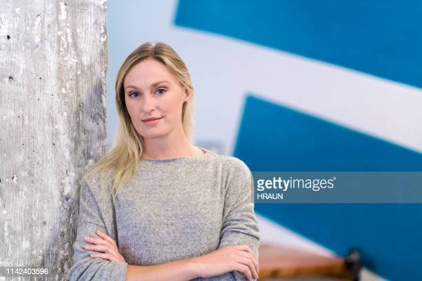 portrait of mid adult woman in office - grey eyes stock pictures, royalty-free photos & images