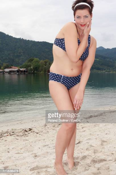 Portrait Of Mid Adult Woman In Swimwear Standing At Lakeshore