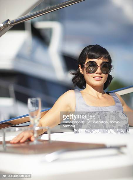 """portrait of mid adult woman on yacht, smiling - """"compassionate eye"""" stock pictures, royalty-free photos & images"""