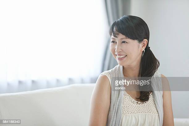 portrait of mid adult woman - suginami stock photos and pictures
