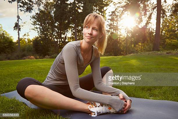 Portrait of mid adult woman practicing yoga in park