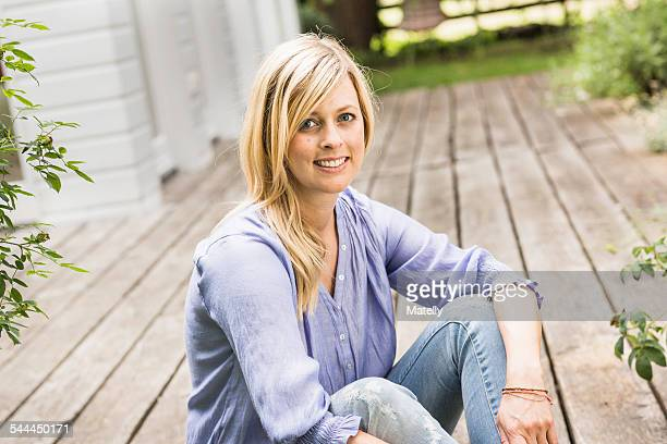 Portrait of mid adult woman sitting on porch