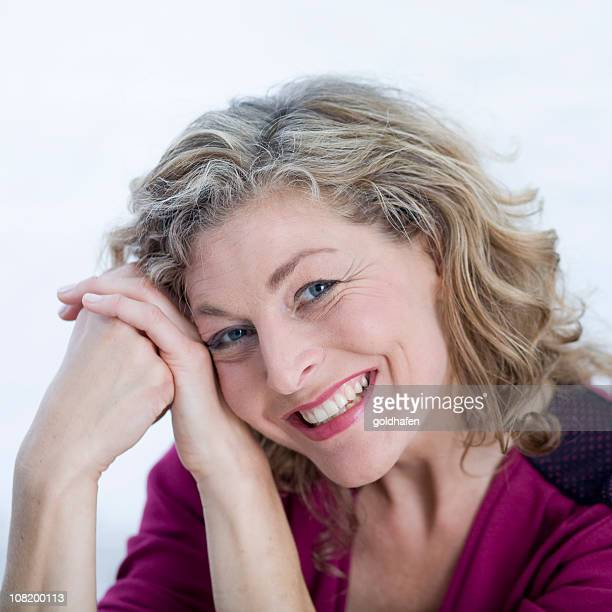 portrait of mid adult woman smiling - grey eyes stock pictures, royalty-free photos & images