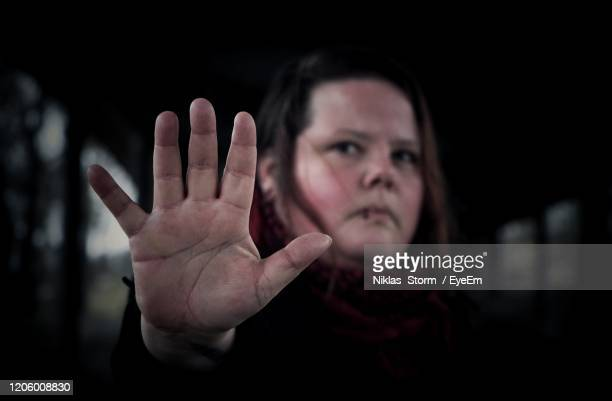 portrait of mid age woman doing stop sign - self defence stock pictures, royalty-free photos & images