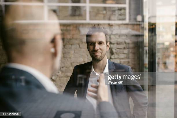 portrait of mid-adult businessman and senior having a meeting - successor stock pictures, royalty-free photos & images